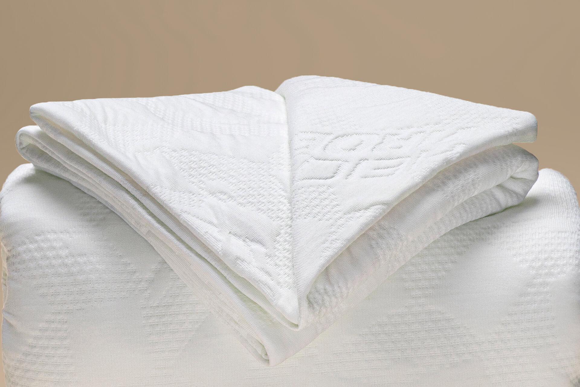 dettaglio coprimaterasso a maglia a cappuccio