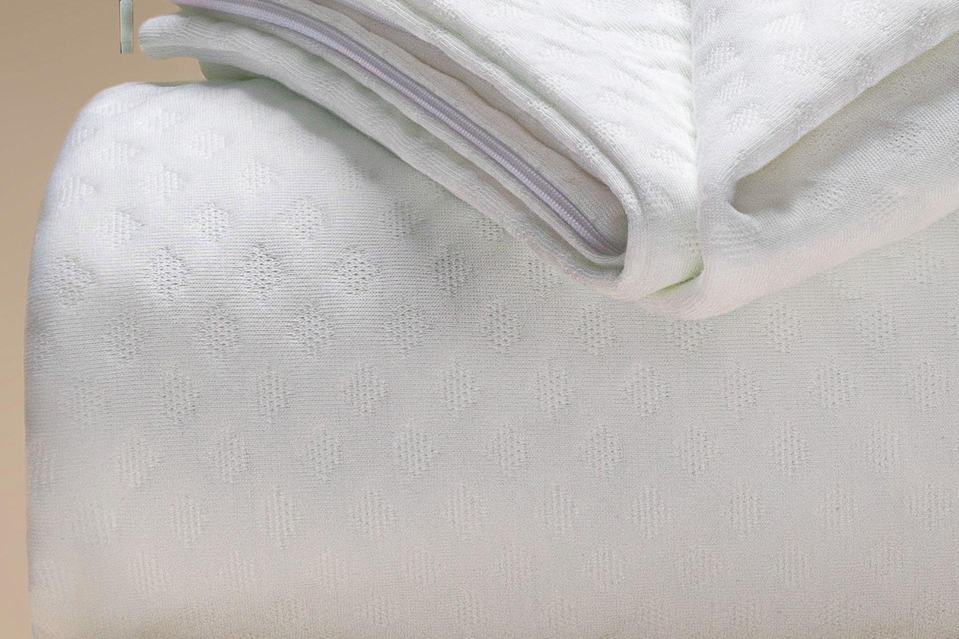 coprimaterasso a maglia semi imbottito tencel a cappuccio dettaglio